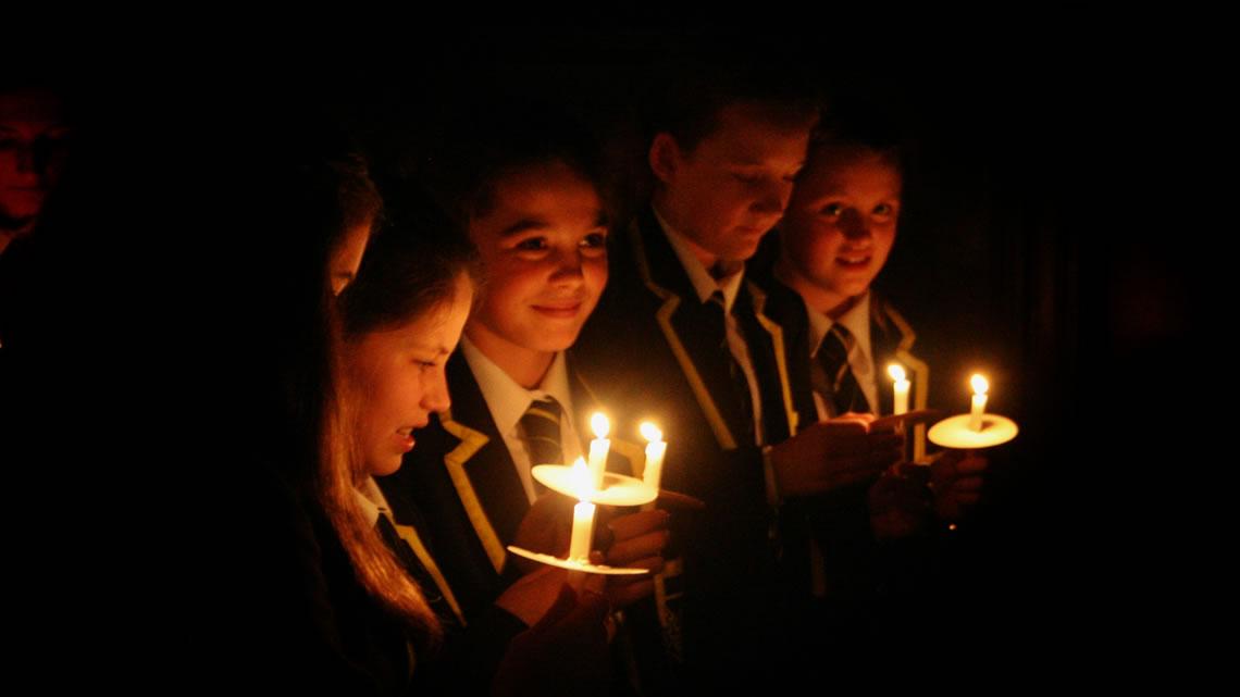 Carol service: candlelit pupils