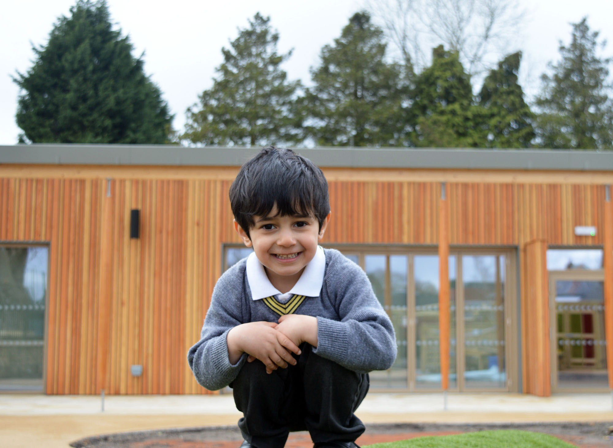 Nursery pupil smiling outside new building