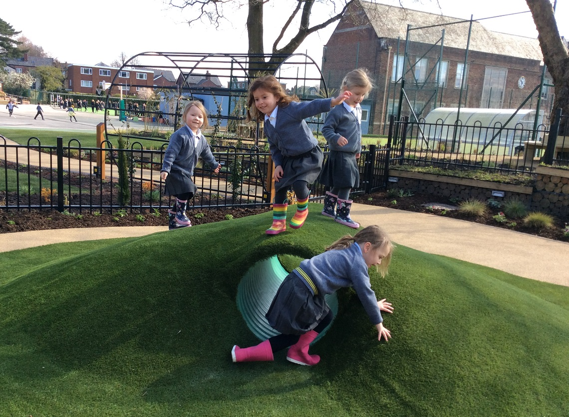 Nursery pupils playing on the hill