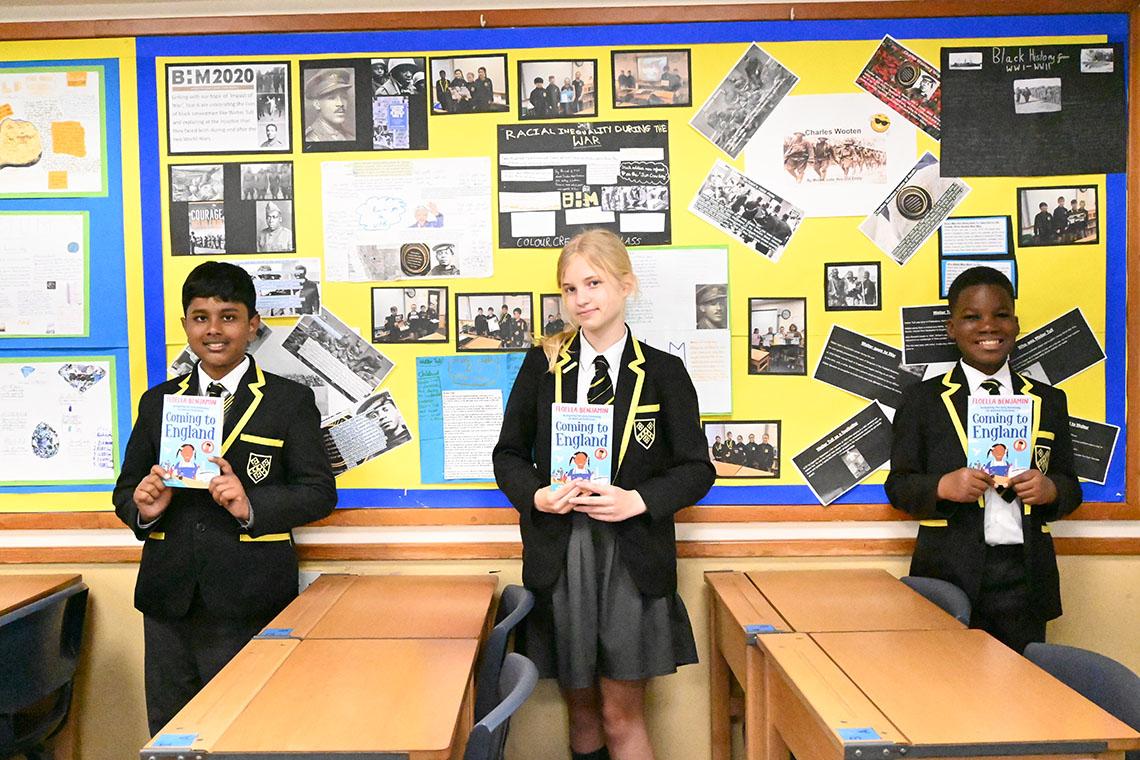 Year Six pupils with Floella Benjamin books