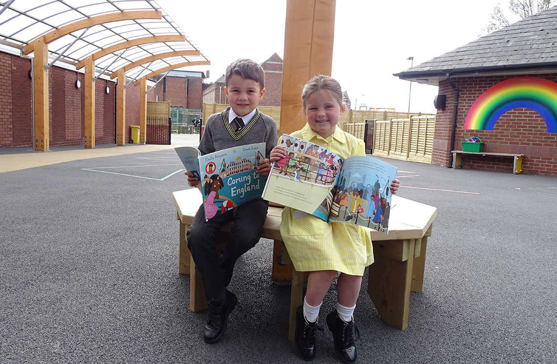 Year One pupils with Floella Benjamin books