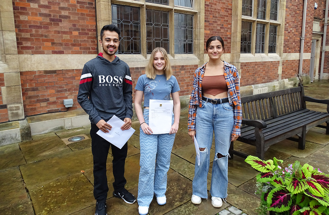 Pleased students collect their A-level results